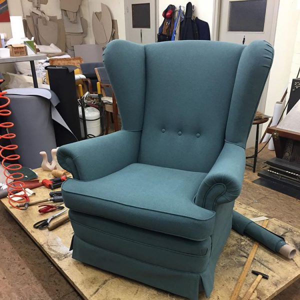 Stoffering blauwe fauteuil